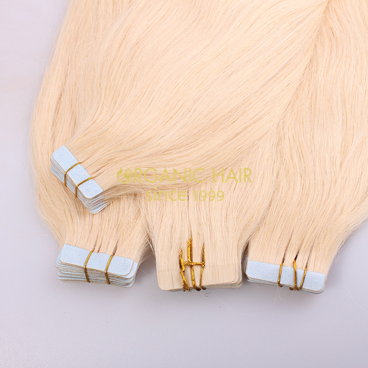 Blonde tape hair extensions
