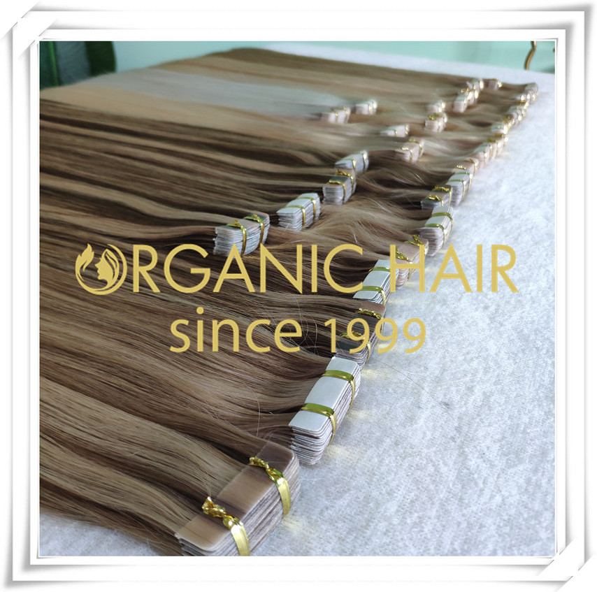 Different colors of tape in hair extensions C062