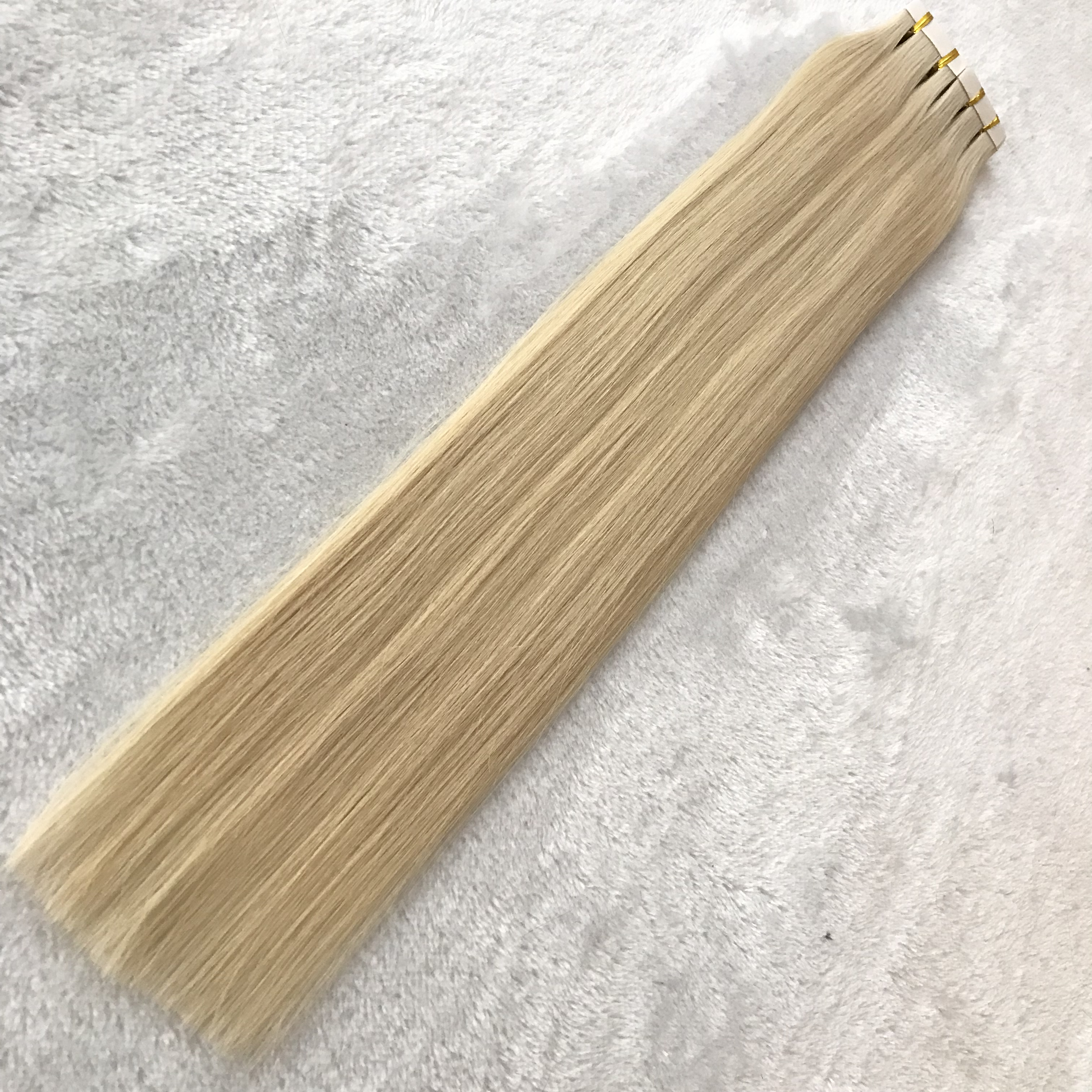 Hot sale wholesale blonde color human tape in hair X300